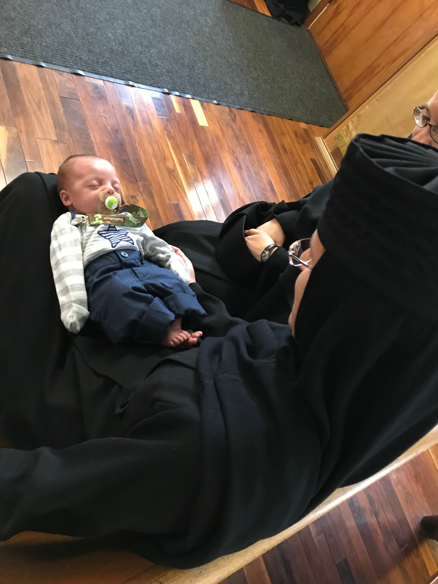 Newborn in the Lap of God